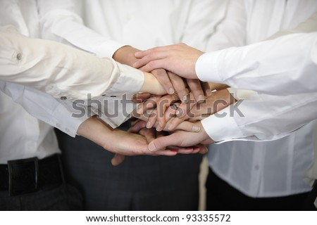 Closeup of a business team with hands together - stock photo