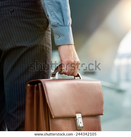 Closeup Of A Businessman Holding Briefcase Going To Work - stock photo