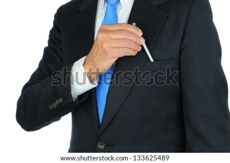 Closeup of a businessman in a suit taking a pen from the breast pocket of his jacket. Torso only, man is unrecognizable. Horizontal format on a white background. - stock photo