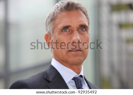 Closeup of a businessman in his fifties - stock photo