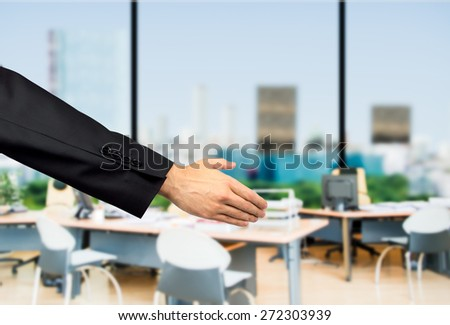 Closeup of a businessman welcoming office - stock photo