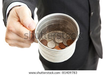 Closeup of a businessman with a tin cup, begging for change.  White background. - stock photo