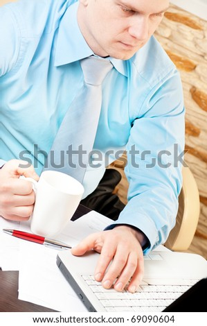 closeup of a businessman working with notebook - stock photo