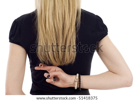 Closeup of a businesswoman with crossed fingers behind her back isolated over a white background - stock photo