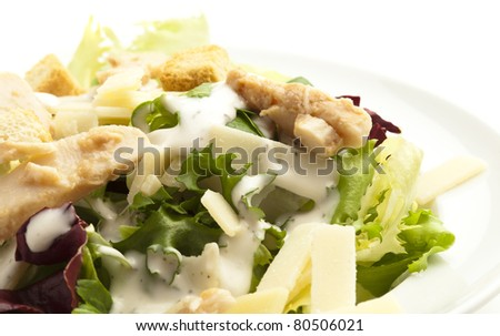 closeup of a caesar salad on white background