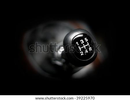 Closeup of a car 5 speed gearstick. - stock photo