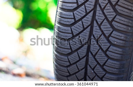 Closeup of a car tire - stock photo
