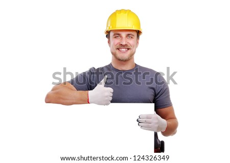 Closeup of a carpenter holding the blank board showing thumbs up - stock photo