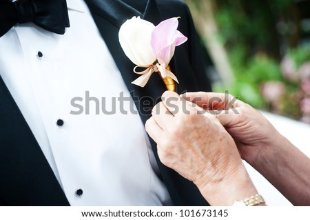 closeup of a ceremony suit with a flower - stock photo