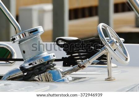 Closeup of a chrome ship's anchor windlass. - stock photo