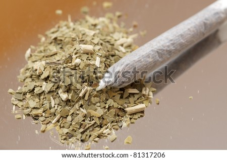 closeup of a  cigarette from hand-rolled marijuana - stock photo