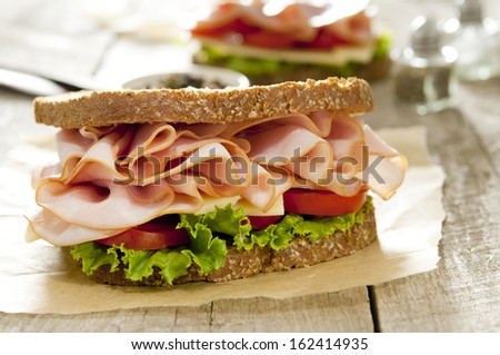 Closeup of a classic ham and cheese sandwich. - stock photo