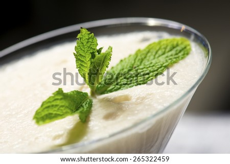 Closeup of a coconut milkshake. - stock photo