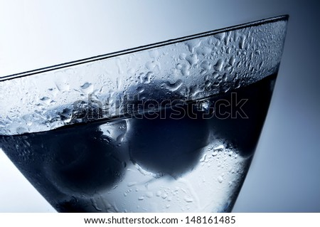closeup of a cold dry martini in a cocktail glass - stock photo