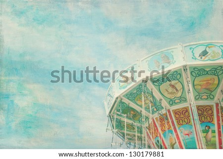 Closeup of a colorful carousel with blue sky background - stock photo