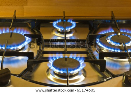 closeup of a cooker hob with the gas lit - stock photo