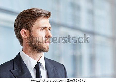 Closeup of a corporate executive looking away thoughtfully and confidently - stock photo