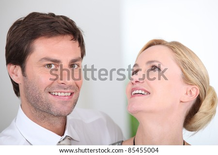 Closeup of a couple laughing - stock photo