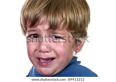Closeup of a crying boy, studio shot - stock photo