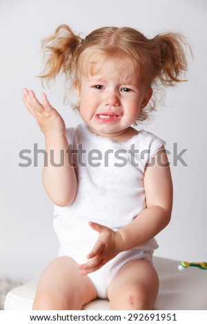 Closeup of a crying little child - stock photo