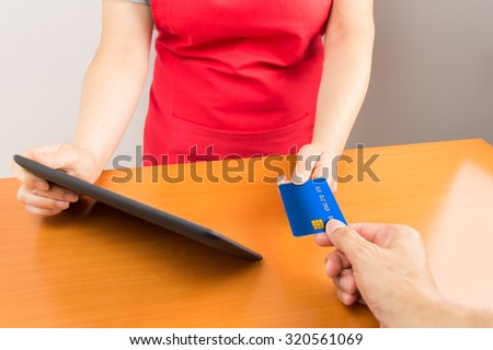 closeup of a customer paying at the store with a credit card - stock photo