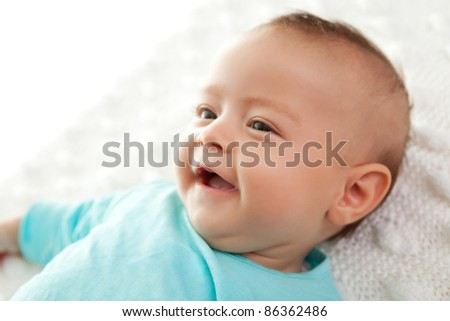 Closeup of a cute little baby smiling - stock photo