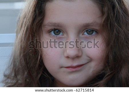 Closeup of a cute small girl - stock photo
