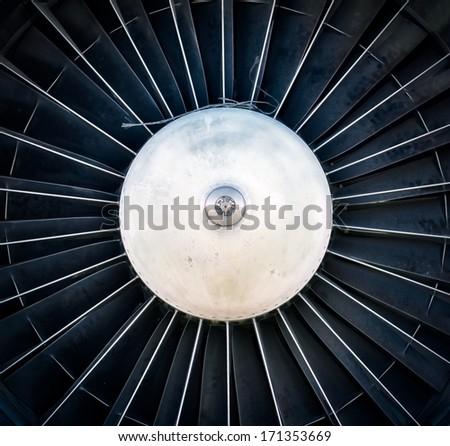 Closeup of a dark jet engine - stock photo