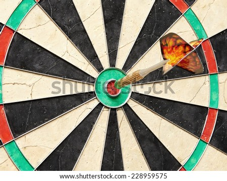 Closeup of a dart sitting in the bullseye of the board