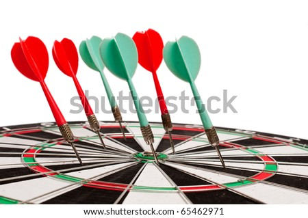 Closeup of a dartboard with six arrows in it isolated on the white background - stock photo