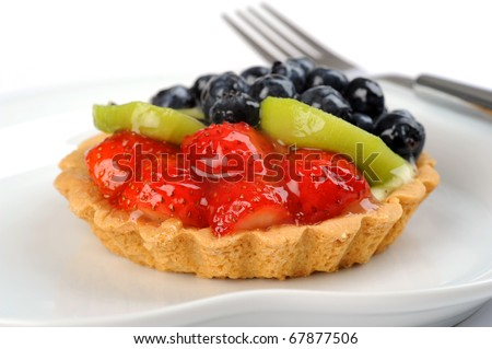 Closeup of a delicious custard filled tart topped with fruit. - stock photo