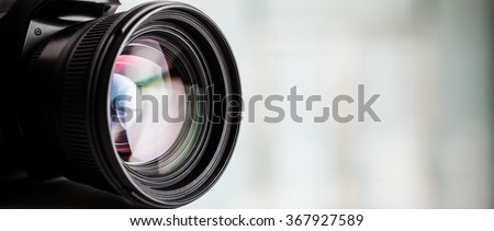 Closeup of a digital camera. Large copyspace - stock photo