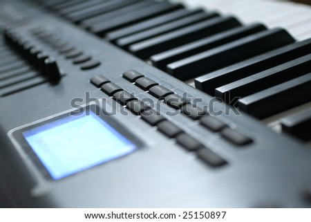 Closeup of a digital piano keyboard, with shallow focus