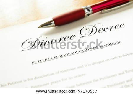 closeup of a divorce decree document with pen - stock photo