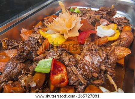 Closeup of a duck szechuan chinese meal on display at a hotel buffet - stock photo