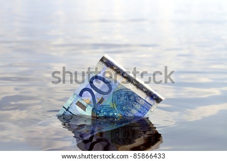 Closeup of a 20-euro note sinking underwater