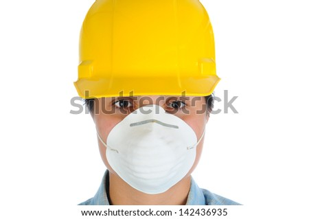 Closeup of a female construction worker wearing a yellow hard hat and dust mask. Horizontal format isolated on white.