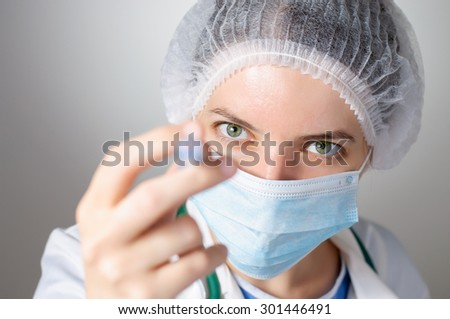 Closeup of a female doctor with syringe - stock photo