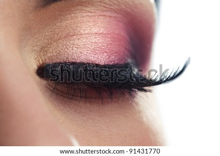 Closeup of a female eye with long false eyelashes - stock photo