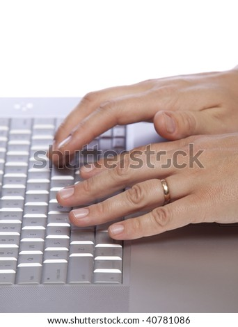 Closeup of a female hands typing on laptop computer