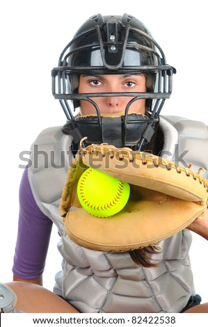 Closeup of a female softball catcher wearing a mask and chest protector holding glove with ball in the web in front of her. Vertical format isolated on white.
