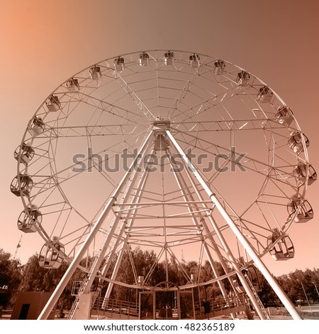 closeup of a Ferris wheel on a background of blue sky on a sunny day