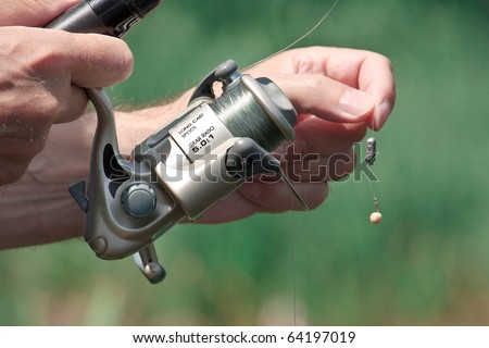 Closeup of a fisherman hand holding a fishing rod