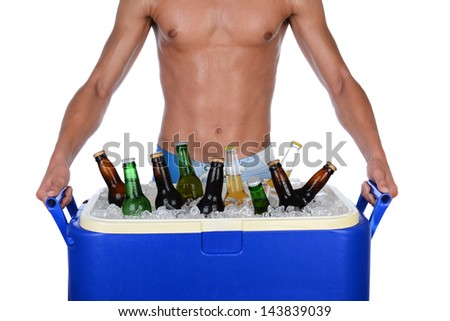 Closeup of a fit young man carrying an ice chest full of beer. Man is shirtless showing torso only. Horizontal format isolated on white. - stock photo
