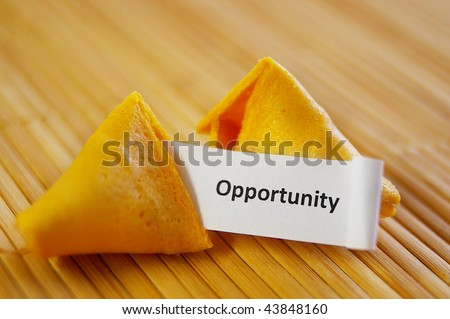 closeup of a fortune cookie with opportunity message - stock photo