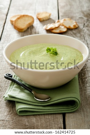 Closeup of a fresh buttermilk, avocado and herb dip with crackers.
