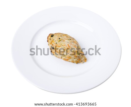 Closeup of a fried chicken cutlet on a plate. Isolated on a white background.   - stock photo