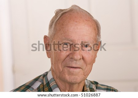 Closeup of a friendly senior citizen man. - stock photo