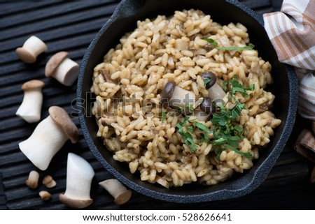 Closeup of a frying pan with porcini risotto, high angle view
