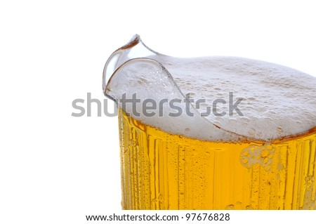 Closeup of a full Beer pitcher over a white background. - stock photo